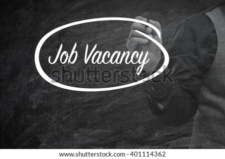 Hand writing Job Vacancy on blackboard. Business and finance, technology, internet concept.