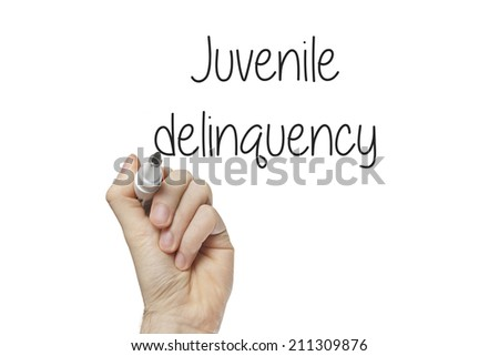 Hand writing juvenile delinquency on a white board - stock photo