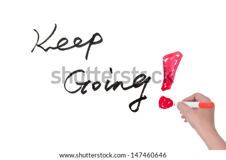 Hand writing Keep going words on white board