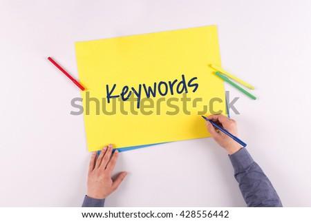 Hand writing Keywords on yellow paper - stock photo