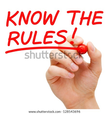 Hand writing Know The Rules with red marker on transparent wipe board. - stock photo