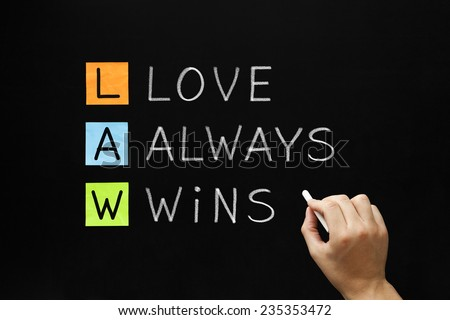 Hand writing LAW - Love Always Wins with white chalk on blackboard. - stock photo
