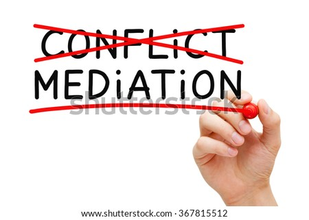 Hand writing Mediation concept with marker on transparent wipe board. To resolve or settle differences by working with all the conflicting parties.