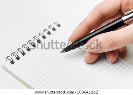 Hand writing message in note against white background - stock photo