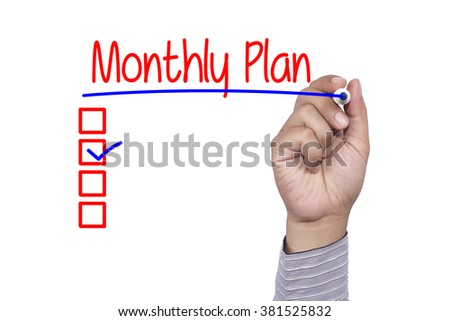 Hand writing monthly plan with blue marker, white background bus - stock photo