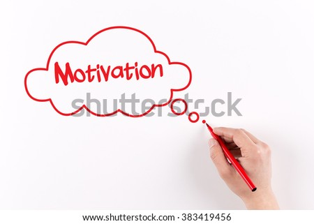 Hand writing Motivation on white paper, View from above - stock photo
