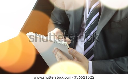 hand writing notes journalist - stock photo