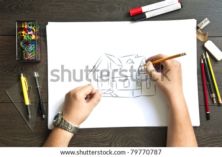 Hand writing on a blueprint  house - stock photo