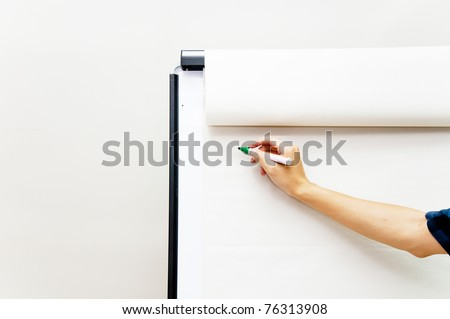 Hand writing on flip chart paper - stock photo
