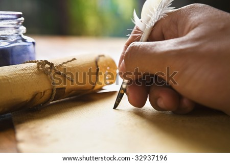 Hand writing on old parchment / paper using quill pen - stock photo