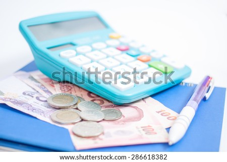 Hand writing on white paper between euro notes and calculator - stock photo