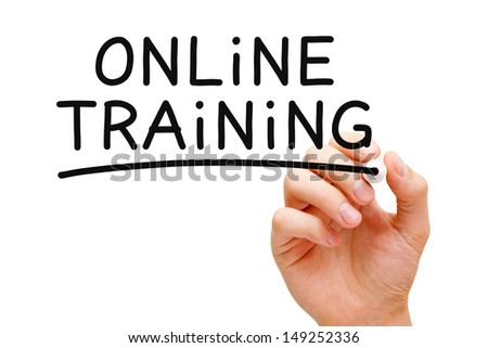 Hand writing Online Training with black marker on transparent wipe board. - stock photo