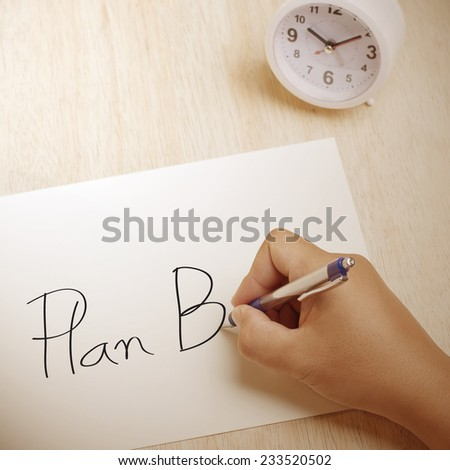 Hand writing Plan B on paper sheet - stock photo