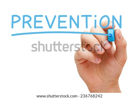 Hand writing Prevention with blue marker on transparent wipe board isolated on white background. - stock photo