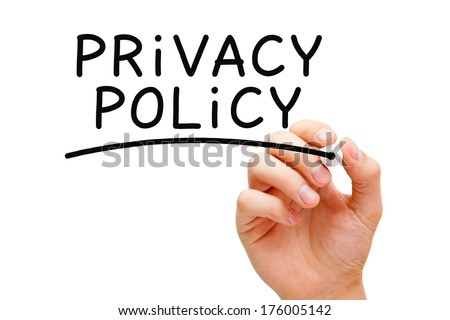 Hand writing Privacy Policy with black marker on transparent wipe board. - stock photo