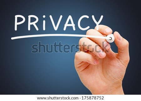 Hand writing Privacy with white marker on transparent wipe board. - stock photo