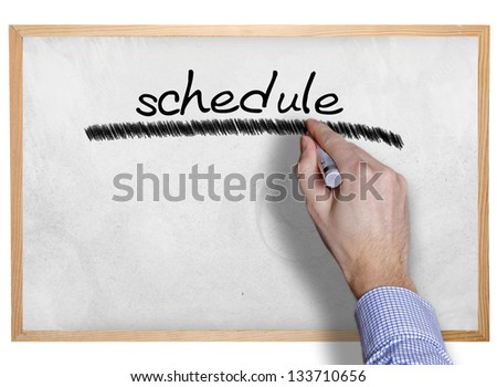 Hand writing schedule on board - stock photo