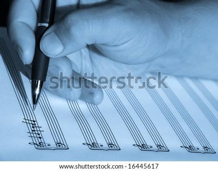 hand writing sheet music notes - stock photo