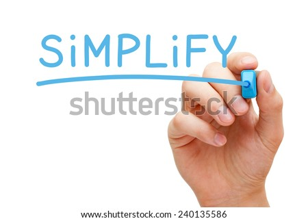 Hand writing Simplify with blue marker on transparent wipe board isolated on white.