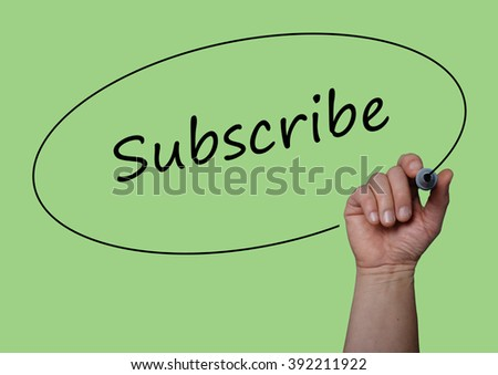 Hand writing SUBSCRIBE  with Marker on  visual screen, board. Life, Love and Business success concept design.