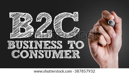 Hand writing the text: B2C - stock photo