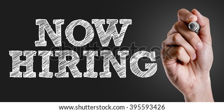 Hand writing the text: Now Hiring - stock photo