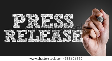 Hand writing the text: Press Release - stock photo