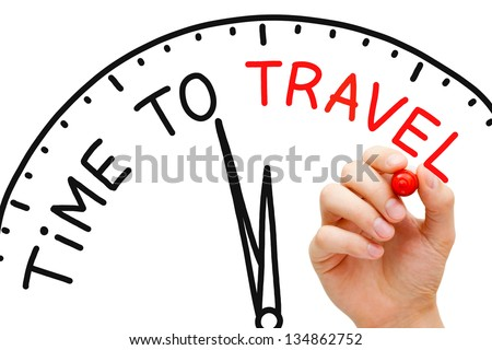 Hand writing Time to Travel concept with red marker on transparent wipe board. - stock photo