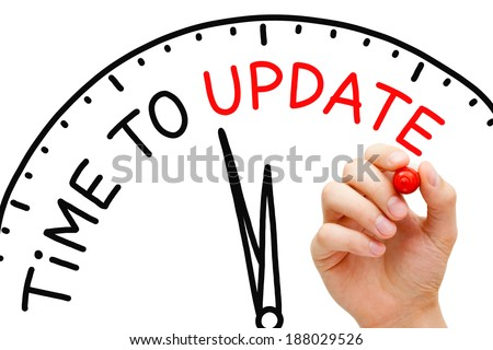 Hand writing Time to Update concept with red marker on transparent wipe board. - stock photo