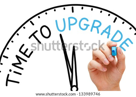 Hand writing Time to Upgrade concept with blue marker on transparent wipe board. - stock photo