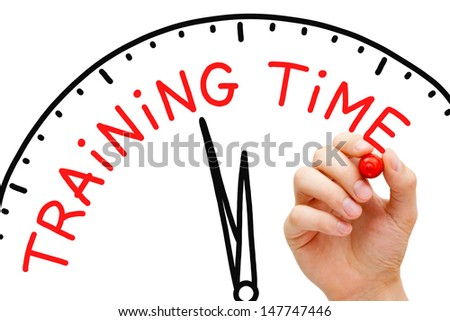 Hand writing Training Time concept with red marker on transparent wipe board. - stock photo