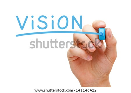 Hand writing Vision with blue marker on transparent wipe board. - stock photo