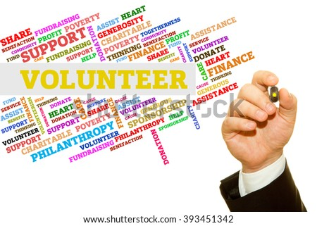 Hand writing Volunteer word on a transparent wipe board. Word collage concept. - stock photo
