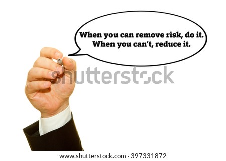 "Hand writing ""When you can remove risk, do it. When you can't, reduce it. "" slogan on a transparent wipe board. Risk management concept."
