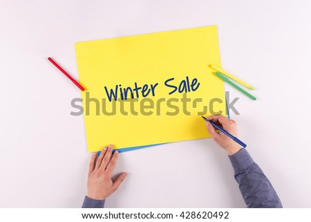 Hand writing Winter Sale on yellow paper - stock photo