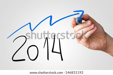 Hand writing with black and blue marker on transparent wipe board - Optimistic about 2014 - stock photo