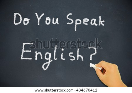 hand writing with chalk of a child learning the English language.Blackboard education concept saying Do You Speak English? written on Chalkboard. - stock photo