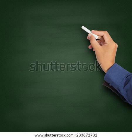 Hand writing with chalk on blackboard - stock photo