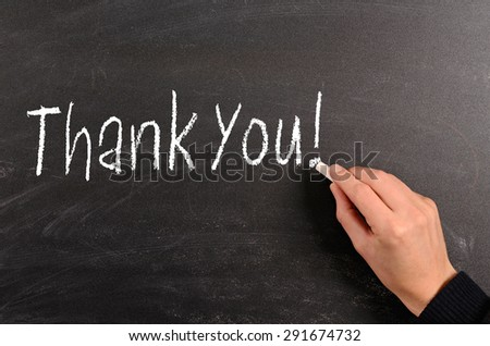 Hand writing with chalk Thank You! on a blackboard - stock photo
