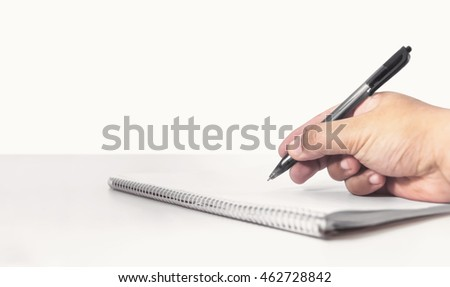 hand writing with pen on a notebook