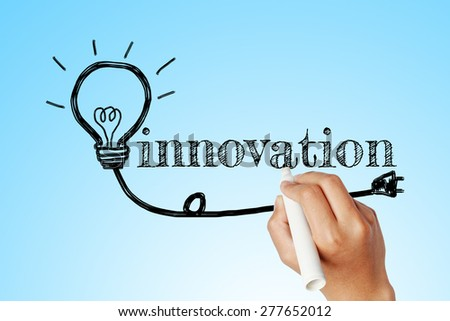 hand writing word of innovation with lightbulb background