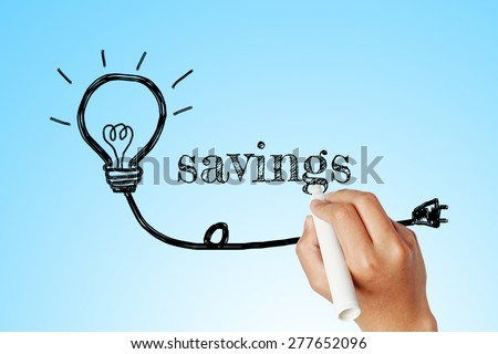 hand writing word of  savings with lightbulb background