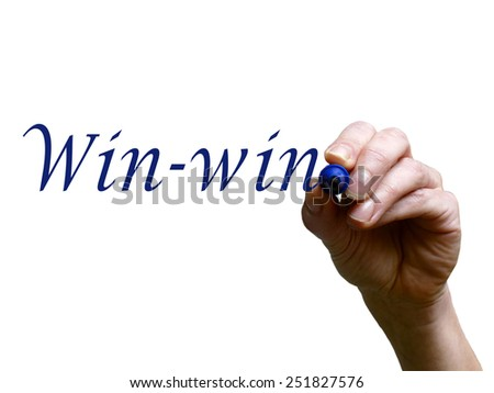 Hand writing words win-win with marker on transparent whiteboard - stock photo
