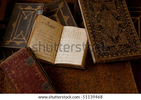 Hand written almanac.  An inventory of cannon installed on 5th Rates Royal Navy ships circa 1720. - stock photo