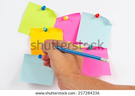 Hand written notes a pencil on a sticker on a white message board - stock photo