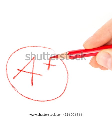 Hand writting mark A+ with red pencil isolated on white  - stock photo