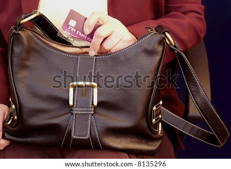 Handbag with the most powerful hand in the world - stock photo