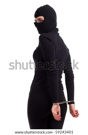 handcuffed female thief in black balaclava, isolated - stock photo