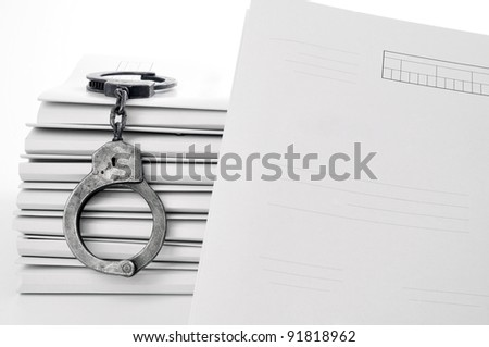 handcuffs and case file blank - stock photo
