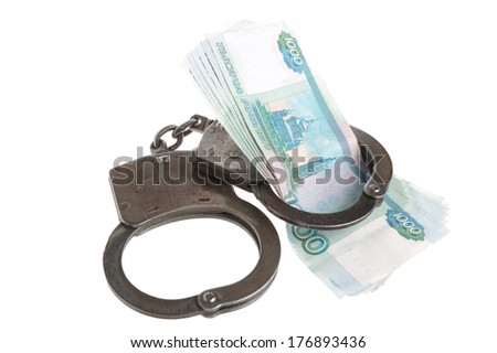 Handcuffs and money isolated - stock photo